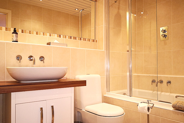 Master bedroom en-suite with over bath shower