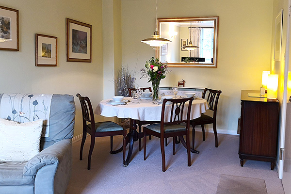 Open plan Lounge and Dining area with seating for 4 guests