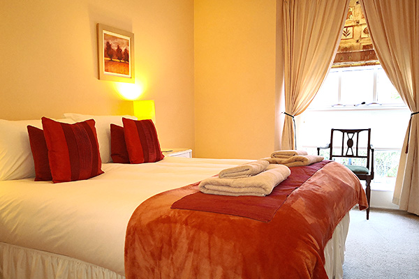 Master en-suite bedroom with King size bed