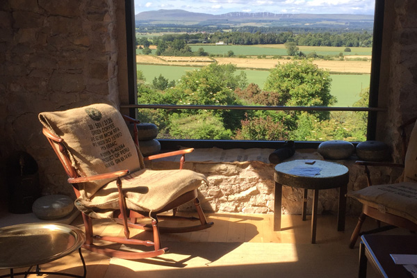 Sunny, summer view from Lounge looking north towards the Trossachs