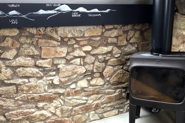 Joyul log burner with chalk drawings of hills visible from lounge window