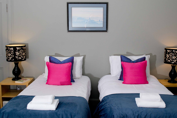 BEDROOM 3: 2 SINGLE BEDS OR ZIPPED AND LINKED SUPER-KING SIZE