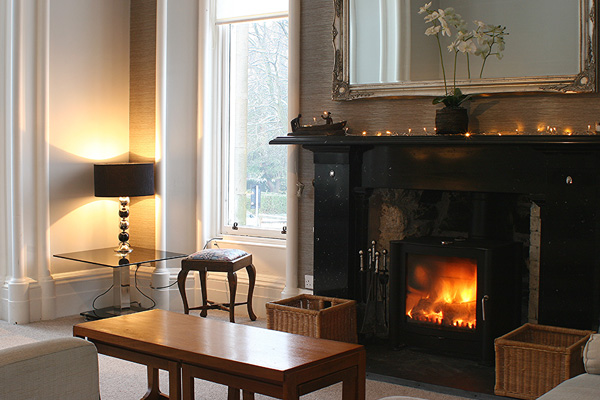Drawing room at front of house with log burning stove