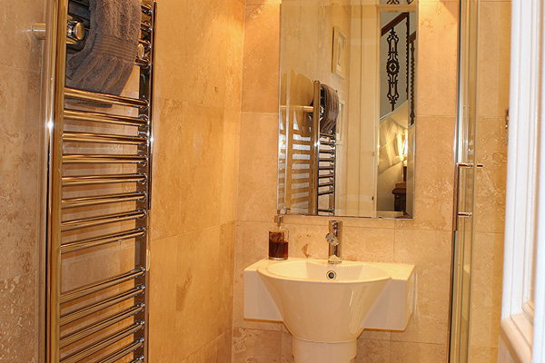 downstairs cloakroom WC with shower cubicle