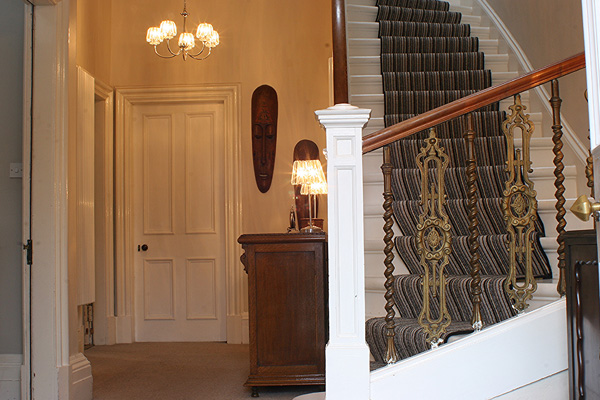 grand, sweeping staircase greets you in entrance hallway