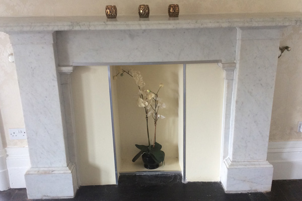 original marble fire place in master bedroom