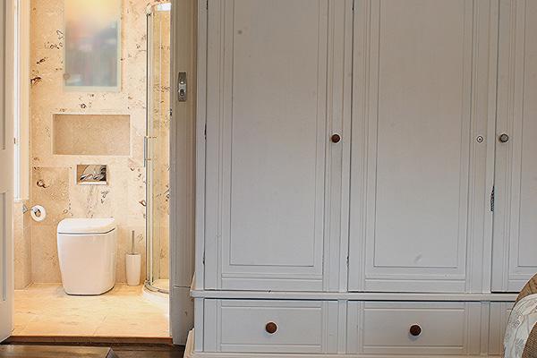 French armoire wardrobe looking through into en-suite