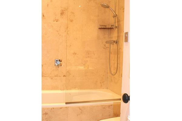 family bathroom with over bath shower