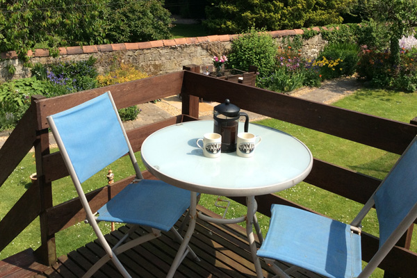 Coffee on the deck? Sit in the morning summer sun and take in the splendid garden