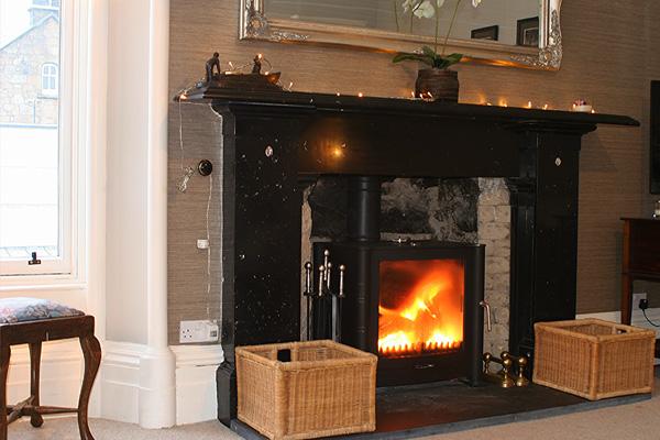 original marble fireplace with log burning stove