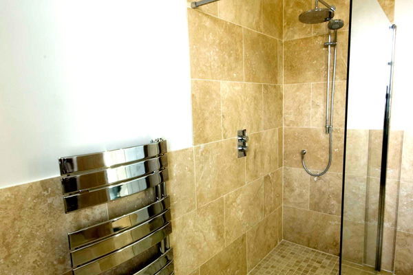 Main bathroom with large bath and walk in drench shower
