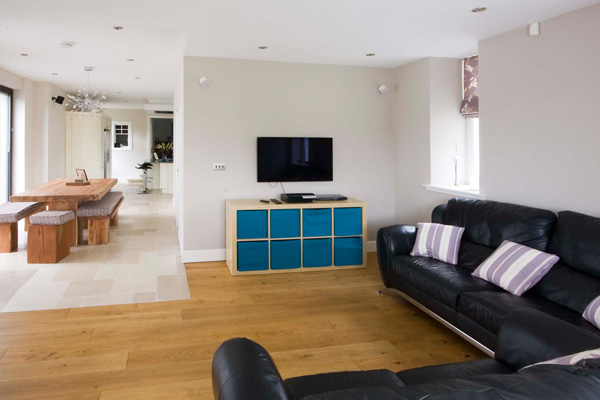Family area with TV, Games console and football table . Bi Fold doors lead to rear