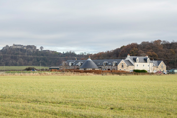 View to the Steadings from access road with Stirling Castle in background